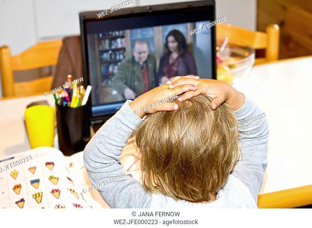 Denmark, Langeland, little girl watching at laptop