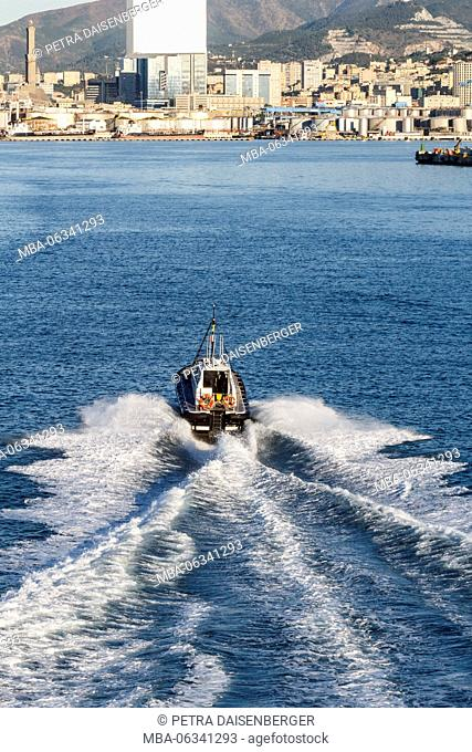 A small, quick ship, while driving from the harbour of Genoa, the Mediterranean Sea, Italy