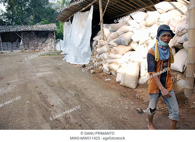 The warehouse in a limestone burnhouse in Kalasan, which obtains its raw limestone from southern Java islands After the country suffered several natural...