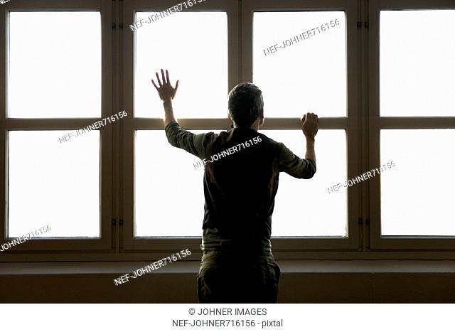 Man standing by a window, Sweden