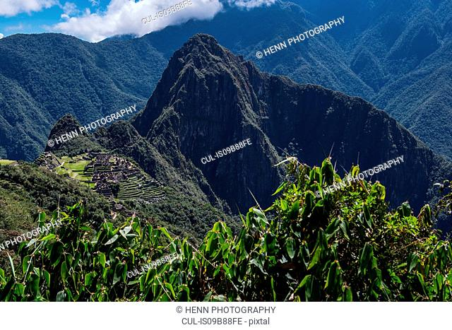 Mountain peak by inca ruins, Machu Picchu, Cusco, Peru, South America