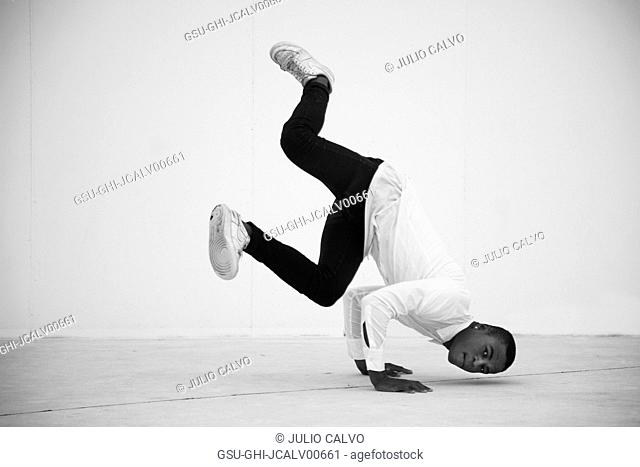 Young Adult Man Doing Handstand during Street Dance