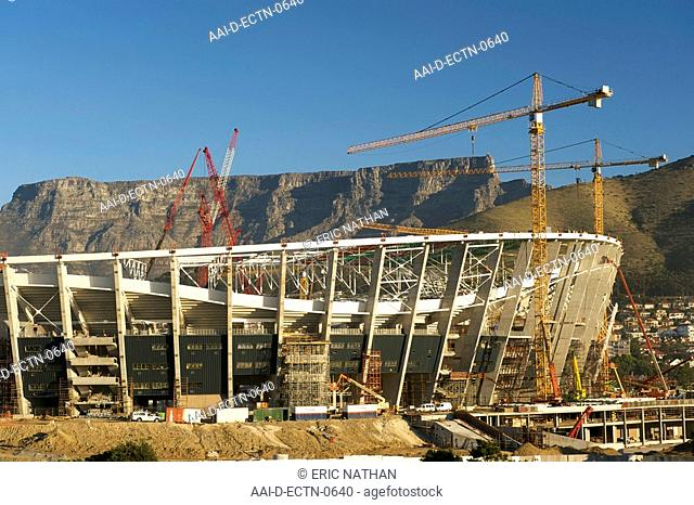 The FIFA 2010 world cup soccer stadium under construction in Greenpoint, Cape Town with Table Mountain in the background