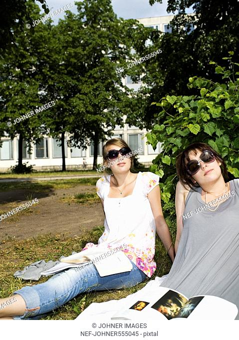 Teenage girls studying outside in the sun, Sweden
