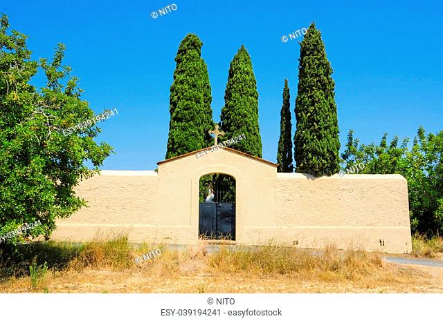 facade with a cross in an old cemetery in Spain