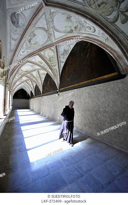 Monk at the cloister of Franciscan monastery, Bolzano, South Tyrol, Alto Adige, Italy, Europe