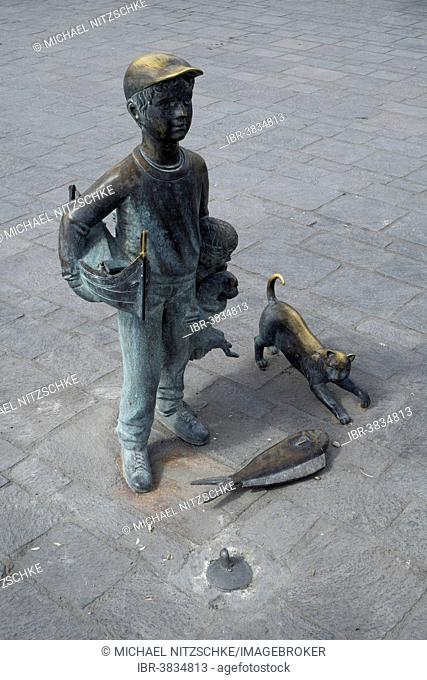 Boy, bronze statue in the harbour of Marsaxlokk, Malta