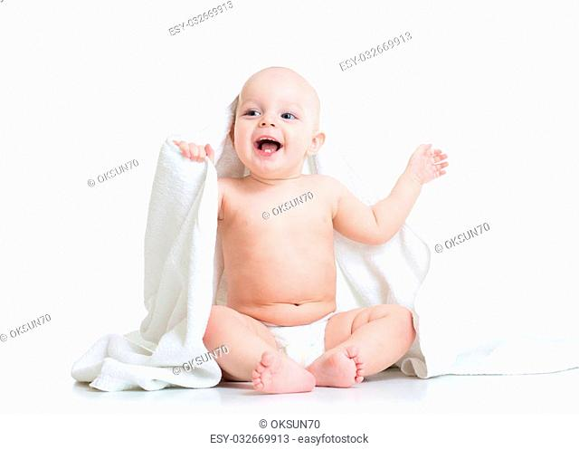 Cute baby boy with towel after bath or shower