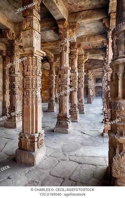 New Delhi, India. Hindu Columns incorporated into the Quwwat Ul-Islam, first Mosque Built in India, 13th. Century. Qutb Minar Complex