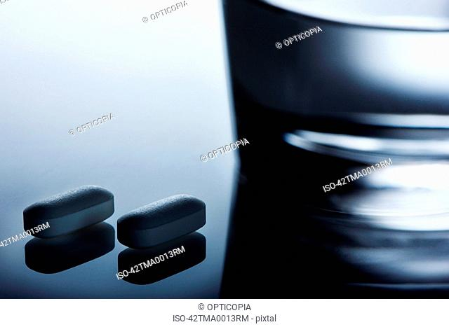 Close up of pills on reflective surface