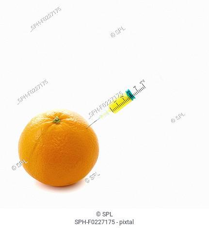 Orange with syringe