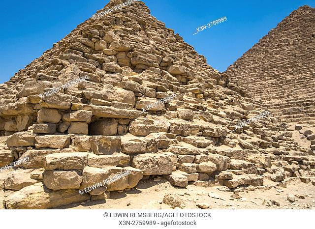 Cairo, Egypt Close up of a mortuary temple in front of one of the Great pyramids of Giza against a clear blue sky. This particular one is The Pyramid of Mekaure