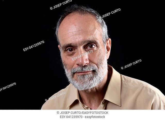 portrait of a middle aged man on black