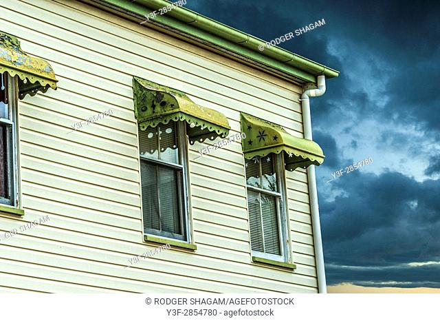 A Queenslander house in an approaching storm
