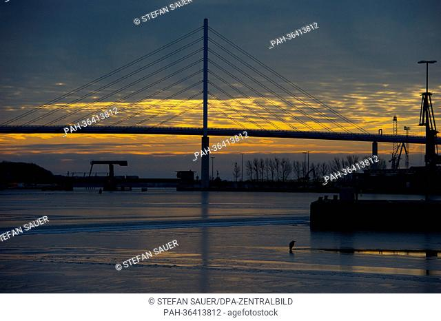 The rising sun shines onto the port of Stralsund, Germany, 24 January 2013.Due to ice on the Baltic Sea fringes, the Stralsund Waterways and Shipping Office...