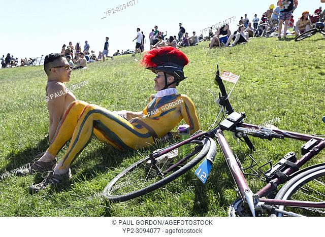 Seattle, Washington: Members of the Solstice Cyclists relax at Gas Works Park after the Summer Solstice Parade and Festival