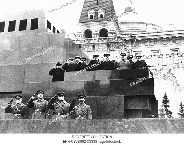 Soviet leaders on Lenin's tomb during for the 19th Anniversary of the October Revolution. Moscow, Nov. 17, 1936. L-R: Mezhlauk, Khrushchev, Chubar or Chubab