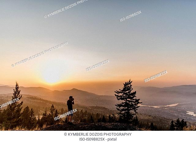 Man enjoying view from hill, Kamloops, Canada