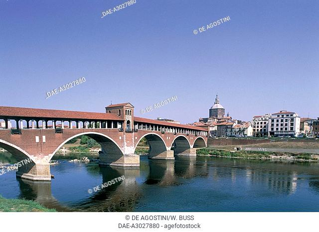The covered bridge over the Ticino river, built in 1949 to the original 14th century structure, Pavia, Lombardy, Italy