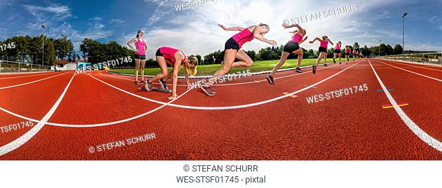 Female runner in starting position, panoramic view, phases