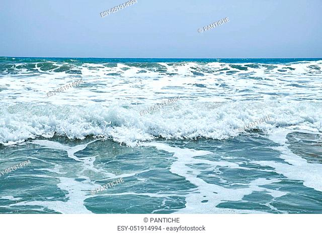 Sea blue bottom summer wave background. Vacation relax on the beach. The beautiful sandy beach of the Mediterranean Sea clean. Beautiful photo