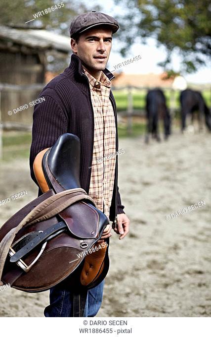 Man Holding Saddle, Baranja, Croatia, Europe