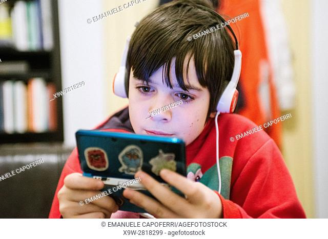 12 year old boy playing with video game
