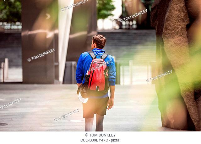 Young man exploring city, London, UK