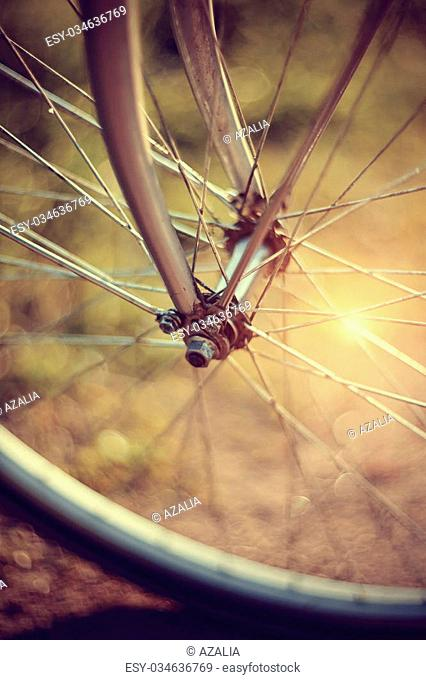 Forward wheel of the bicycle close up with bokeh