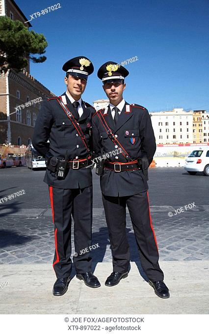 full length of Two Arma Dei Carabinieri Italian police officers on duty in Piazza Venezia Rome Lazio Italy