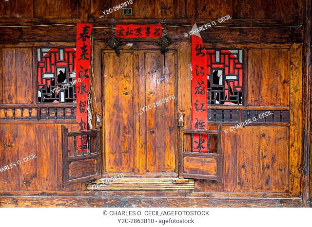Matang, a Gejia Village in Guizhou, China. Doorway to Private Home with Spring Festival (New Year) Scrolls Quoting Poetry by Bai Juyi
