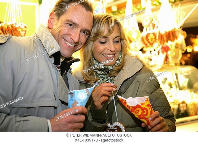 happy couple on christmas market