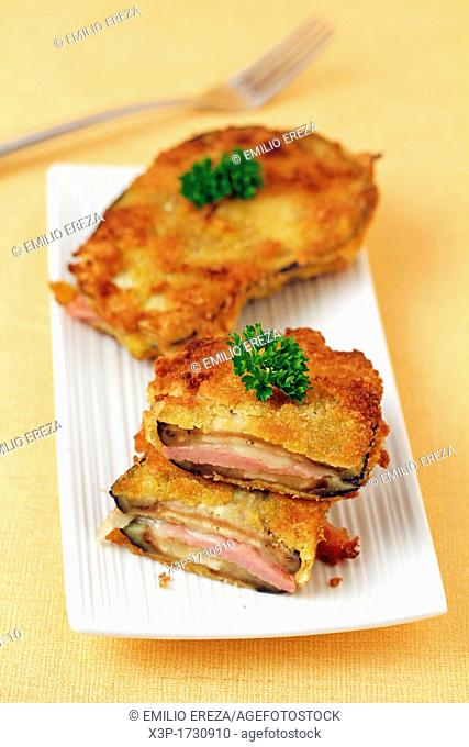 Breaded aubergines with ham and cheese