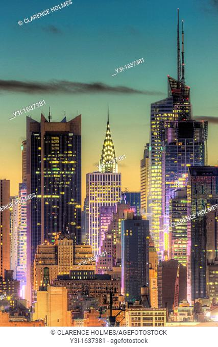 The Chrysler Building, Bank of America Tower, and other buildings near 42nd Street in New York City during morning twilight as viewed over the Hudson River...
