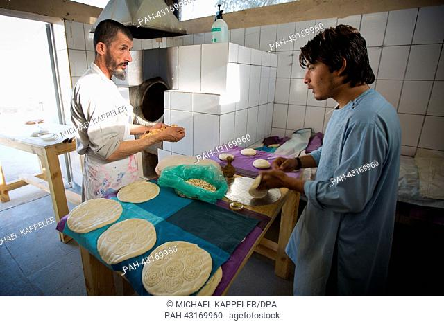 Afghan bakers prepare bread at the field camp of the German ISAF troops in Kunduz, Afghanistan, 06 October 2013. In the former kitchen of the German armed...