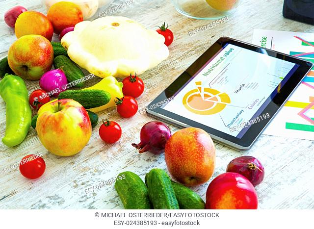 Organic food and a Tablet PC showing information about healthy nutrition and phytochemical composition