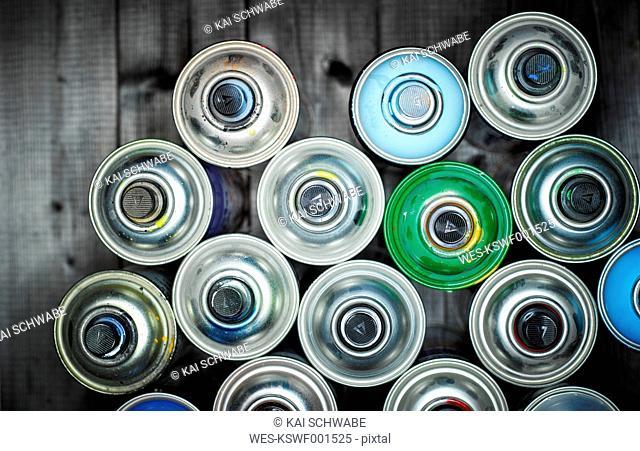 Aerosol cans on wood