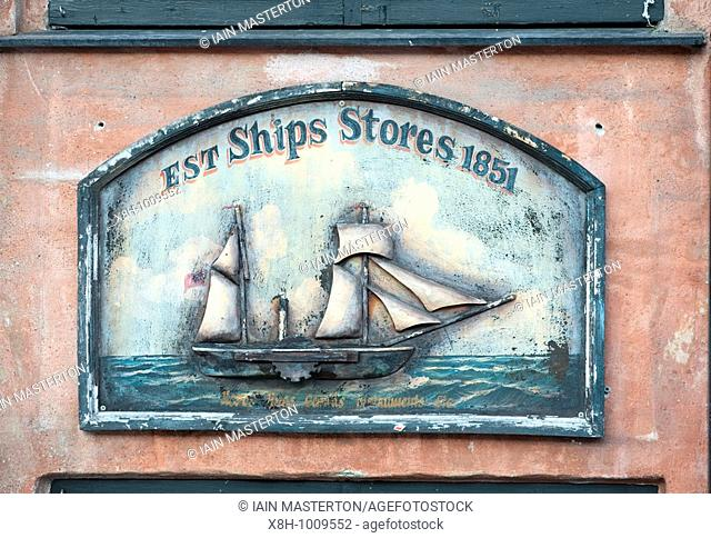 Detail of old sign outside bar and restaurant at Nyhavn in Copenhagen Denmark