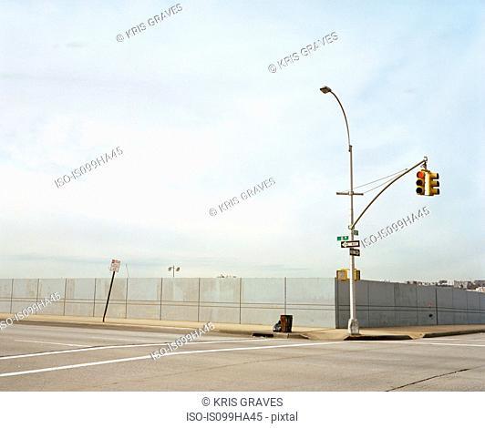 Empty street with traffic lights
