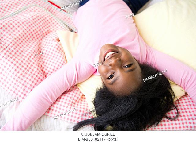 Black girl laying on bed