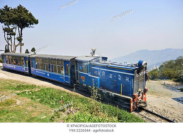 """The Darjeeling Himalayan Railway, also known as the """"""""Toy Train"""""""", is a 2 ft (610 mm) narrow gauge railway that runs between New Jalpaiguri and Darjeeling in..."""