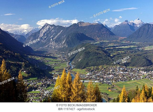 Telfs am Inn, view from Moesern to the Inntal valley, larch trees in autumn, on the right Mieminger Plateau, Oberinntal Upper Inn Valley, Tyrol, Austria, Europe