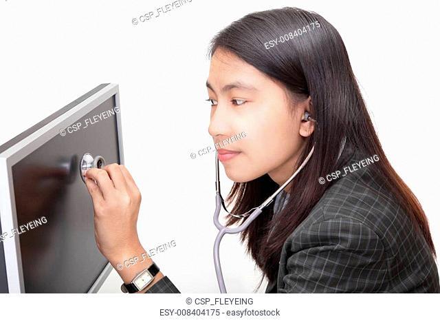 Businesswoman examining PC screen w stethoscope