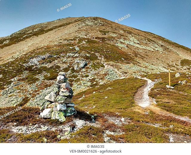 Route (PR AS-10) to Cornón Peak (2.188 m.)in background from Santa Maria del Puerto. Somiedo Natural Park. Asturias. Spain