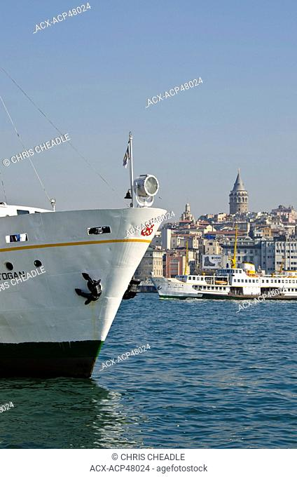 Ferry Bow on the Golden Horn with Beyoglu district and Galata Tower beyond, Istanbul, Turkey