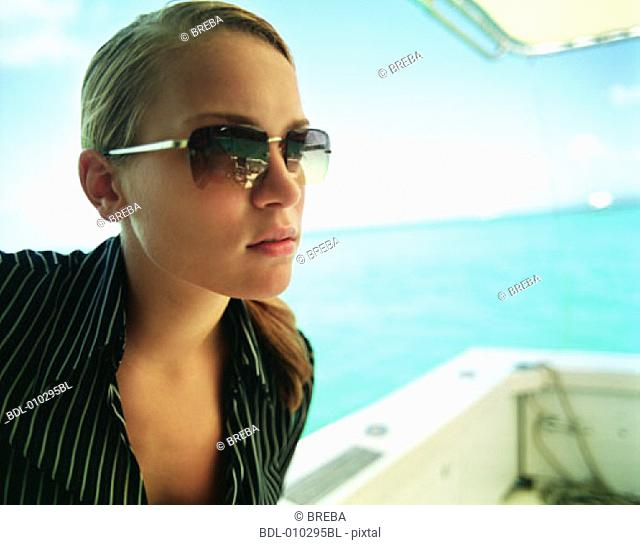 young woman model posing on yacht