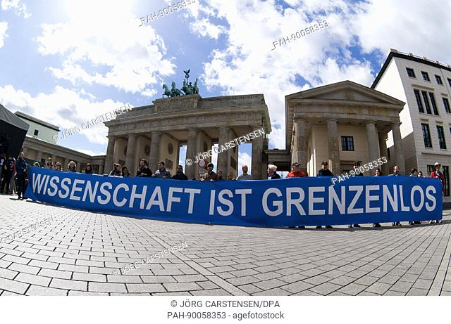 "A banner reading """"Science is without borders"""" can be seen at the """"March for Science"""" in front of the Brandenburg Gate in Berlin, Germany, 22 April 2017"