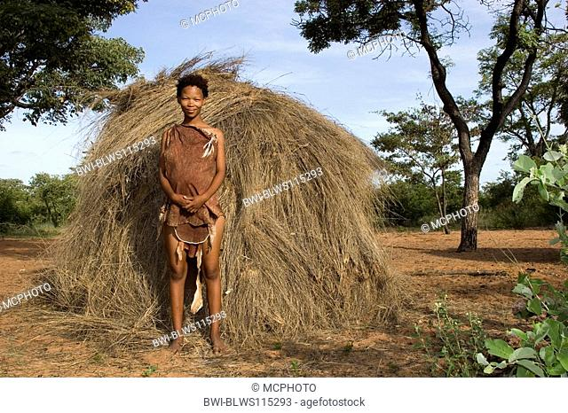 bushman woman in front of her traditional grass hut, Namibia
