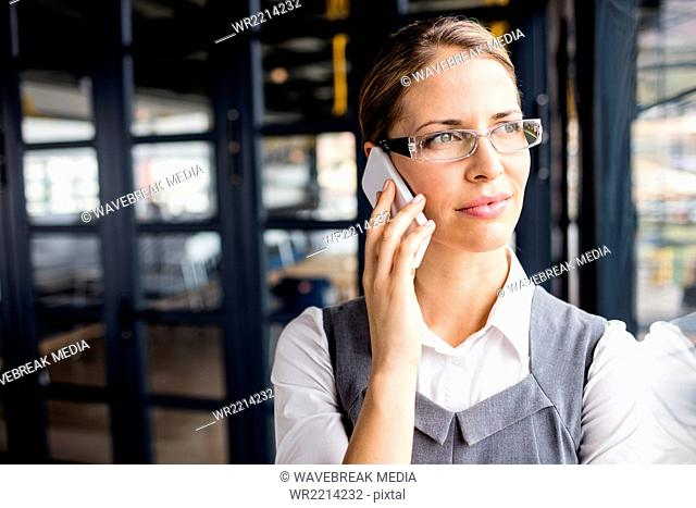 Portrait of a thoughtful businesswoman having a phone call