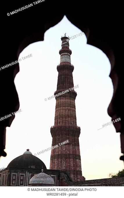 Sunset at Qutab Minar built in 1311 red sandstone tower , Indo-Muslim art , Delhi sultanate , Delhi, India UNESCO World Heritage Site